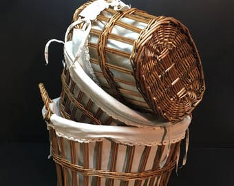 Set of 3 French vintage wicker basket. Woven wicker in nice oval shape with wider top than base. With pretty cotton liners