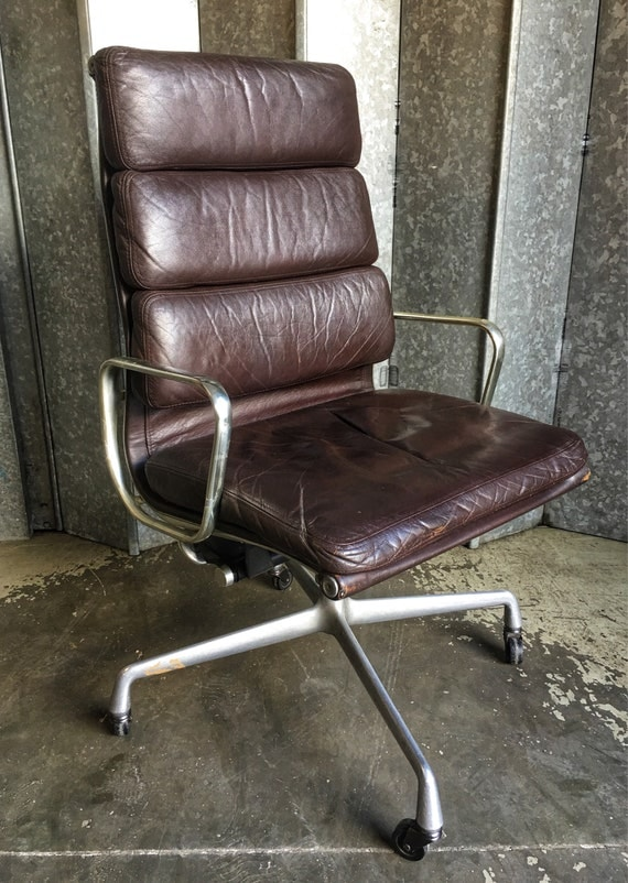 Charles & Ray Eames model ea 219 soft pad original Herman Miller model Mastermind chair in burgundy leather