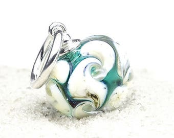 Handmade glass pendant with silver details