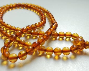 Small: 108 beads baltic amber mala for meditation (size Ø5 colour 4)