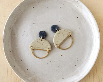 Silhouette Earrings - Grey Granite & Speckled Sand with a Brass Semi Circle Silhouette.