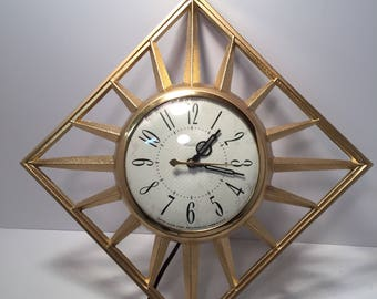 Mid Century United gold metal starburst wall clock