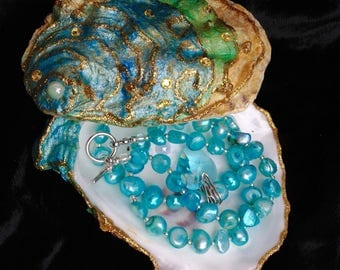 SOLD ELSEWHERE! Blue pearl necklace with crystal heart in painted oyster shell