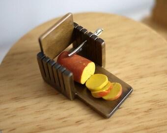 Dollhouse miniature bread on cutting board