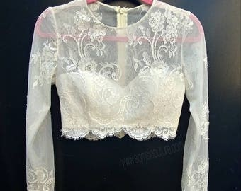 Stunning ivory boho chic lace crop top with faux pearls button detail.