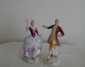 Pair of Royal Dux Regency Man And Lady Figurines