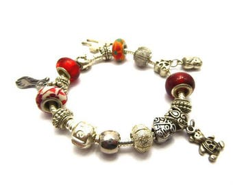 Serpentine link and glass beads and charms