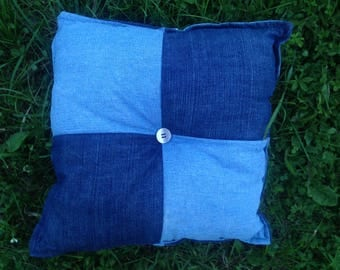 Decorative hand made pillow from recycled jeans filled with silicone fluff