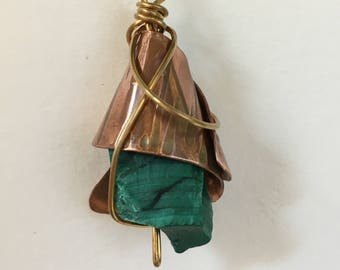 Malachite pendant enclosed in copper and wire-wrapped with brass - properties of protection from negative energies