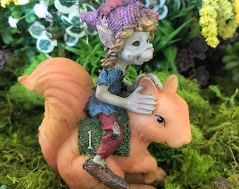 Miniature Pixie Riding a Squirrel