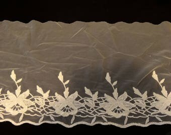 Ivory tulle with embroidered flowers