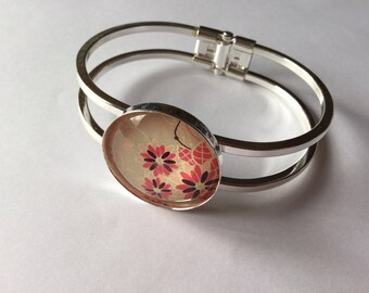 Silver Bangle and stylized flowers beige background glass cabochon