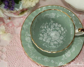 Aynsley, England: Sage green tea cup & saucer with white flowers