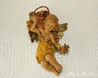 E. Simonetti, Italy: Cherub, angel figurine with fruit basket