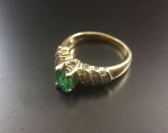 14K yellow gold ring with emerald and diamonds, size 6, weight 3.8 grams