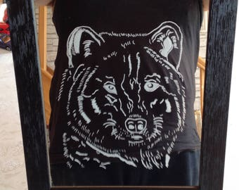 Engraving of a Wolf on mirror with a black wooden frame.
