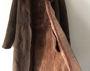 Brown sheepskin fur coat woman size medium .