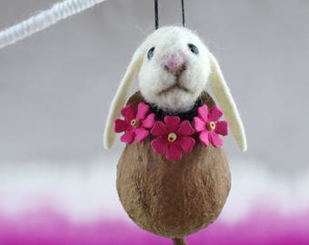 Needle felted gum nut critter, hanging.  Small white bunny rabbit.
