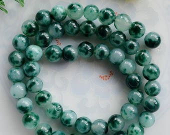 7 ROUND 7 MM MULTICOLOR JADE BEADS.