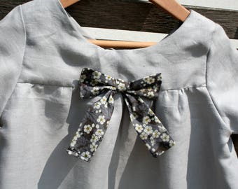 Grey linen with a pretty bow in liberty dress