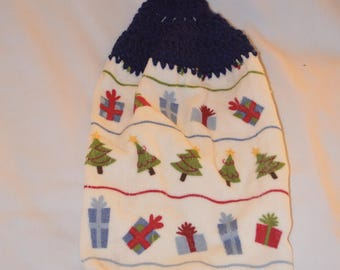 Crocheted Navy Blue Kitchen Towel With Presents And Christmas Trees On White
