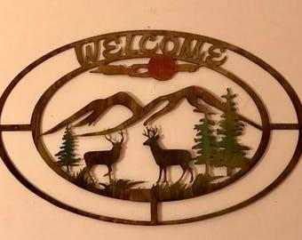 Deer mountain scene metal welcome sign