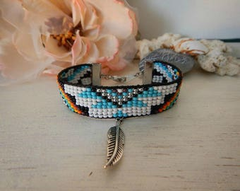 Ethnic bracelet beads, cord and feather