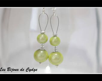 Earrings and pale green magic beads
