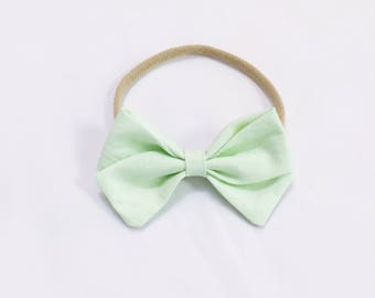 Pastel baby green bow headband