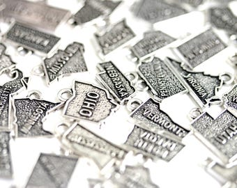 US State Charms. Pick One of 50 State Charms. Add-On Charm for Bracelet Charm or Necklace Charm. Christian Charm. Silver Plated Charm.
