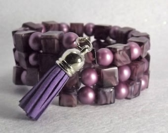 Bracelet of glass beads on memory wire, purple with charm
