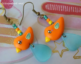 Earrings in bronze metal with an orange kawaii bird made with polymer clay and beads
