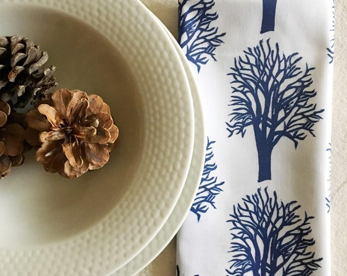 set of four organic cotton dinner napkins, cherry trees in navy blue