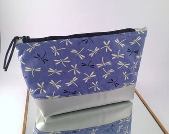 Silver make-up pouch and blue dragonfly