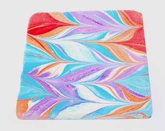 Hand marbled tile with chevron design.(030