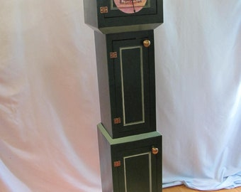 Grandfather clock storage cabinet with mice at tea clock face