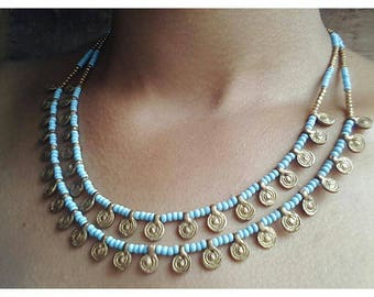Delicate brass necklace.