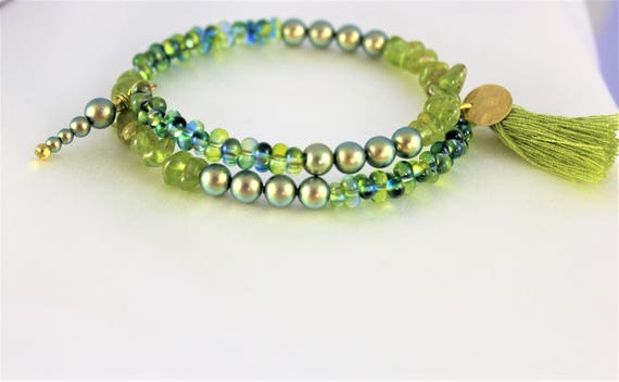 boho chic bracelet with charms, swarovski pearl beads imitating the cultured pearls, peridot and seed beads