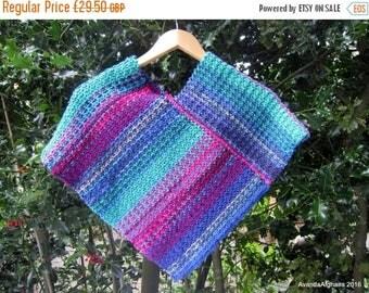 ON SALE Child's poncho (Mac's poncho). Purple poncho, blue poncho. Knit in wool / acrylic mix. Reversible.