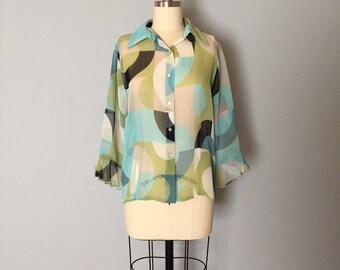 geometric print blouse | sheer minimalist blouse | sea glass green and blue ruffled sleeves blouse