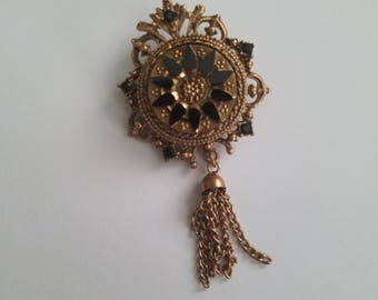 Vintage gold toned denise brooch with black stones