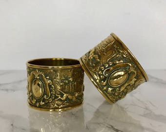 Pair of brass napkin rings with hunting decor