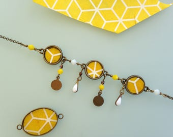"Yellow and white Japanese paper ""Trinket"" bracelet."