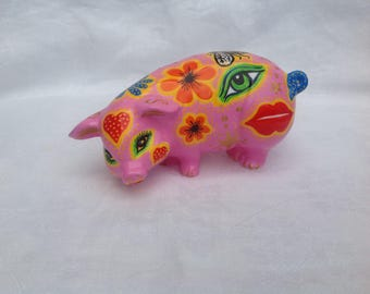 Handpainted ceramic flower power pig in psychedelic colours
