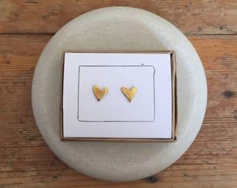 Brass heart shaped stud earrings.