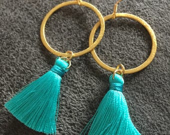 Gold earrings with teal tassel