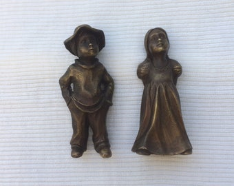 boy and girl small sculpures  made from brass.lost wax casting size 78mm hight. 34mm wide