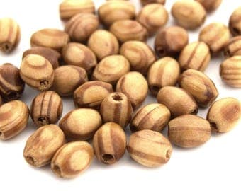 100 beads in natural pine oval 8 x 5 mm