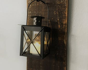 Rustic Black Lantern | Wall Decor | Hanging from a black hook on a reclaimed wood plank.