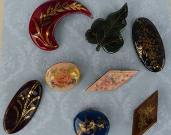 A Vintage Collection of Eight Enamel on Copper Decorative Brooches.